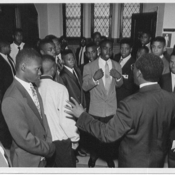 Deacon Wyatt Jones, Jr., the first Dean of Students at Loyola, meets with 43 freshmen in September 1993 who will comprise the school's first ever graduating class four years later.